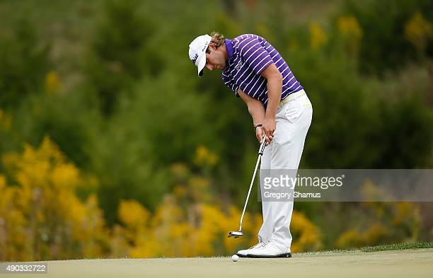 Andrew Loupe putts for birdie on the 16th green during the final round of the Webcom Tour Nationwide Children's Hospital Championship at The Ohio...