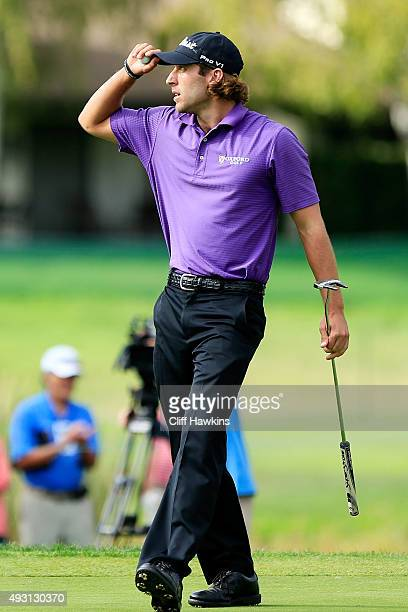 Andrew Loupe reacts after putting on the 18th green during the third round of the Fryscom Open on October 17 2015 at the North Course of the...
