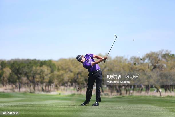 Andrew Loupe takes his second shot on the 1st during the Final Round of the Valero Texas Open at TPC San Antonio ATT Oaks Course on March 30 2014 in...