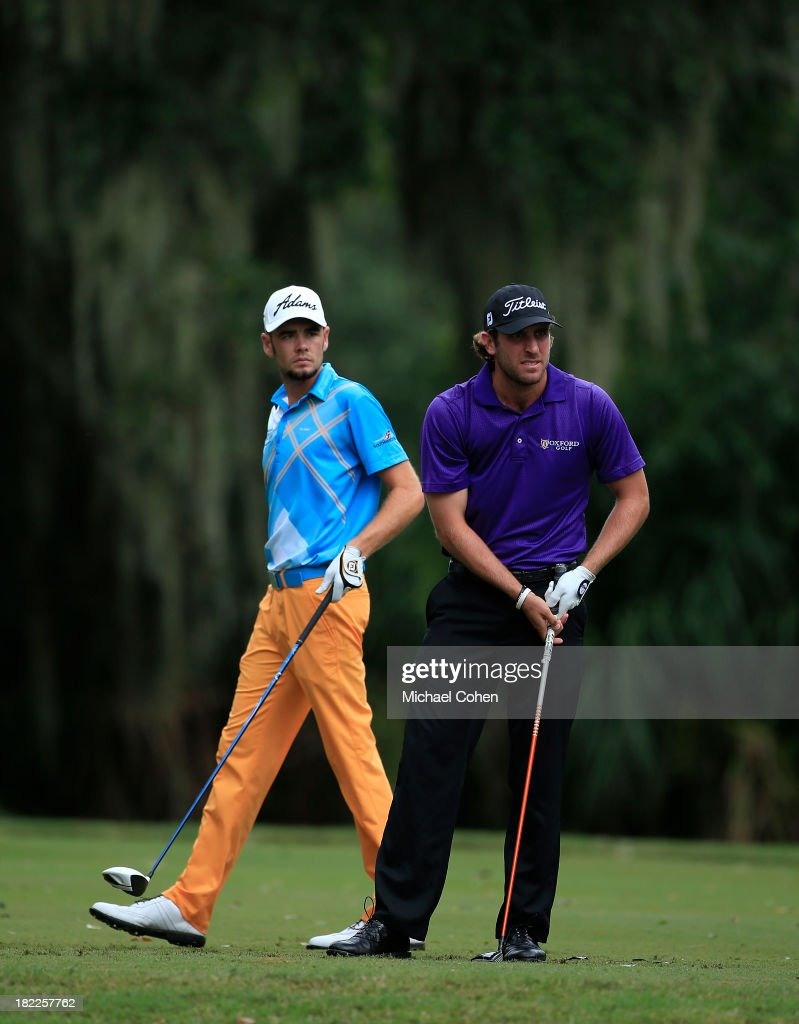 Andrew Loupe (R) watches his drive on the third hole as Troy Merritt looks on during the third round of the Web.com Tour Championship held on the Dye's Valley Course at TPC Sawgrass on September 28, 2013 in Ponte Vedra Beach, Florida.