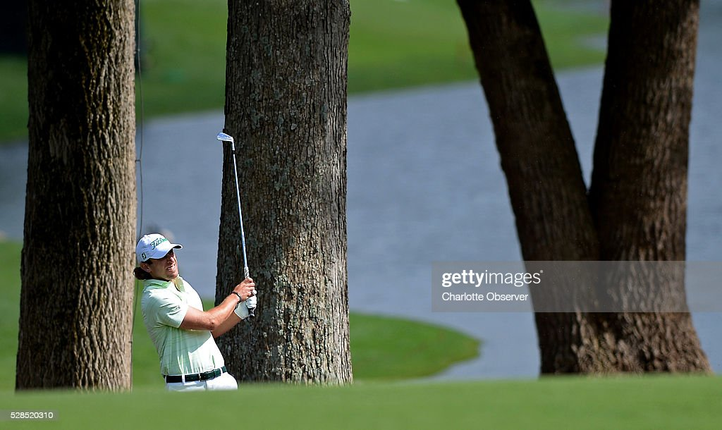 Andrew Loupe watches his shot from the 15th fairway during the first round of the Wells Fargo Championship at Quail Hollow Club in Charlotte, N.C., on Thursday, May 5, 2016.