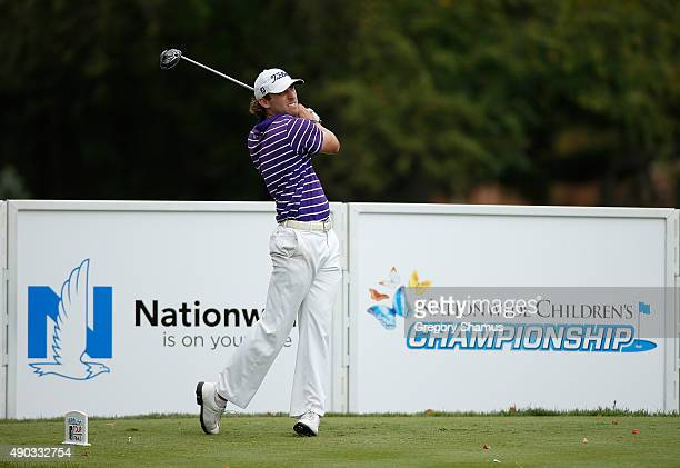 Andrew Loupe watches his tee shot on the 18th hole during the final round of the Webcom Tour Nationwide Children's Hospital Championship at The Ohio...