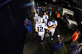Andrew Luck and Khaled Holmes of the Indianapolis Colts walk off the field after being defeated by the New England Patriots in the 2015 AFC...