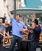 Andrew Luck and Mario Lopez visit 'Extra' at Universal Studios Hollywood on July 14 2014 in Universal City California