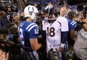 Andrew Luck of the Indianapolis Colts and Peyton Manning of the Denver Broncos meet after the game at Lucas Oil Stadium on October 20 2013 in...