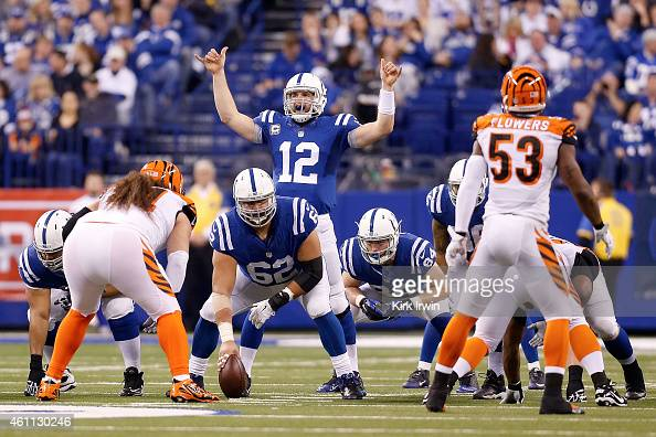 Andrew Luck of the Indianapolis Colts calls a play at the line of scrimmage during the game against the Cincinnati Bengals on January 4 2015 at Lucas...