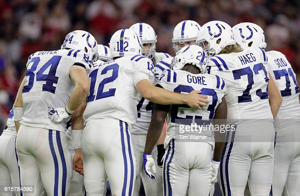 Andrew Luck of the Indianapolis Colts calls a play in the huddle during the fourth quarter of the NFL game between the Indianapolis Colts and the...