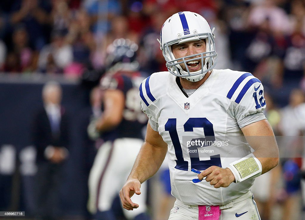 Andrew Luck of the Indianapolis Colts celebrates against the Houston Texans in the fourth quarter in a NFL game on October 9 2014 at NRG Stadium in...