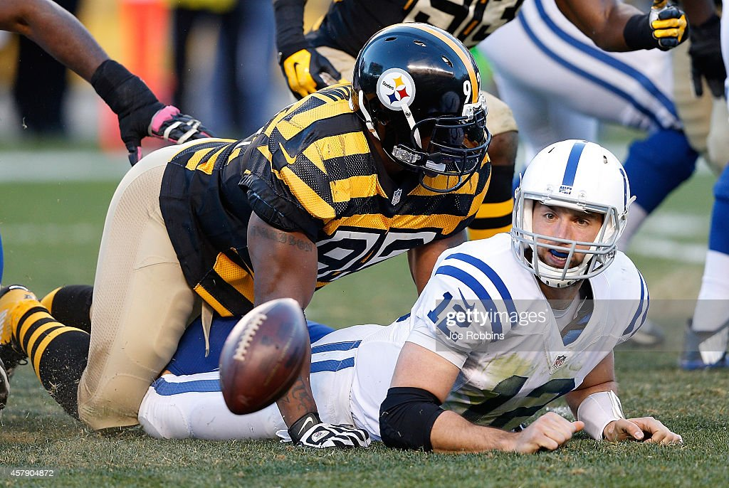 Andrew Luck #12 of the Indianapolis Colts fumbles the ball after being hit by James Harrison #92 of the Pittsburgh Steelers during the second quarter at Heinz Field on October 26, 2014 in Pittsburgh, Pennsylvania.