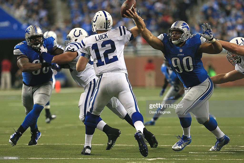 <a gi-track='captionPersonalityLinkClicked' href=/galleries/search?phrase=Andrew+Luck&family=editorial&specificpeople=6258221 ng-click='$event.stopPropagation()'>Andrew Luck</a> #12 of the Indianapolis Colts gets pressure from <a gi-track='captionPersonalityLinkClicked' href=/galleries/search?phrase=Ndamukong+Suh&family=editorial&specificpeople=5545543 ng-click='$event.stopPropagation()'>Ndamukong Suh</a> #90 and <a gi-track='captionPersonalityLinkClicked' href=/galleries/search?phrase=Nick+Fairley&family=editorial&specificpeople=6549342 ng-click='$event.stopPropagation()'>Nick Fairley</a> #98 of the Detroit Lions at Ford Field on December 2, 2012 in Detroit, Michigan. The Colts won 35-33