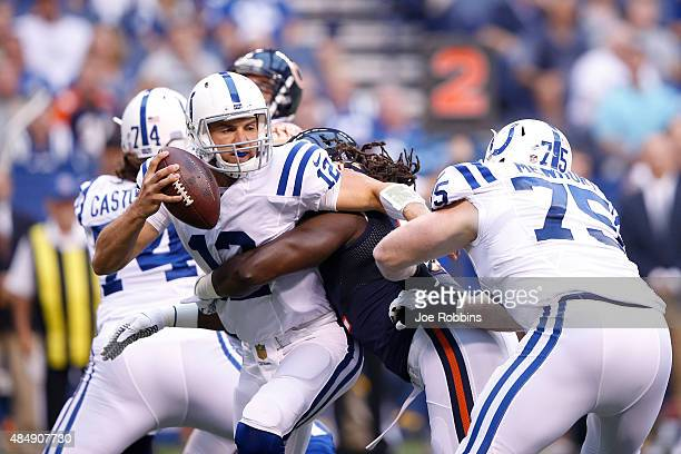 Andrew Luck of the Indianapolis Colts gets sacked by Pernell McPhee of the Chicago Bears in the first half of a preseason game at Lucas Oil Stadium...