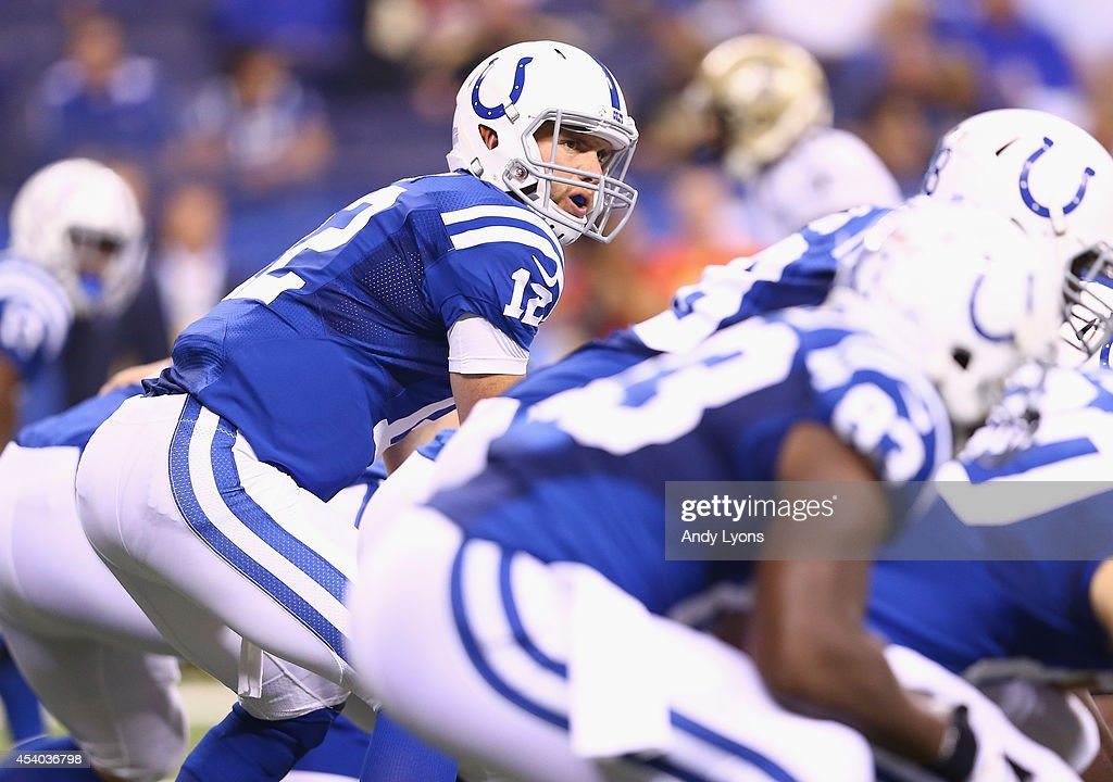 Andrew Luck of the Indianapolis Colts gives instructions to his team against the New Orleans Saints before the exhibition game at Lucas Oil Stadium...
