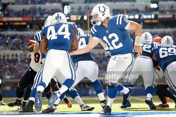 Andrew Luck of the Indianapolis Colts hands the ball off to Ahmad Bradshaw of the Indianapolis Colts while backed up to the one yard line during the...