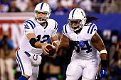 Andrew Luck of the Indianapolis Colts hands the ball off to Trent Richardson in the in the first quarter against the New York Giants during their...