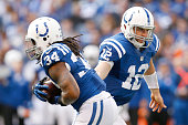Andrew Luck of the Indianapolis Colts hands the ball off to Trent Richardson of the Indianapolis Colts during the third quarter against the...