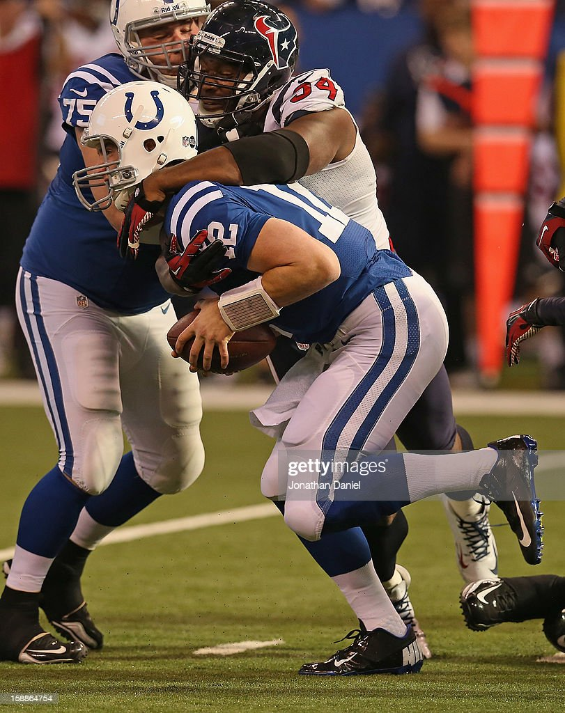 <a gi-track='captionPersonalityLinkClicked' href=/galleries/search?phrase=Andrew+Luck&family=editorial&specificpeople=6258221 ng-click='$event.stopPropagation()'>Andrew Luck</a> #12 of the Indianapolis Colts is sacked by Antonio Smith #94 of the Houston Texans at Lucas Oil Stadium on December 30, 2012 in Indianapolis, Indiana. The Colts defeated the Texans 28-16.