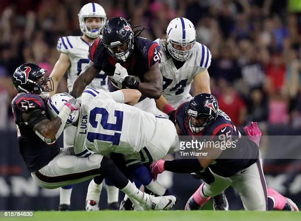 Andrew Luck of the Indianapolis Colts is sacked by Benardrick McKinney of the Houston Texans along with Jadeveon Clowney and Christian Covington in...