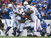 Andrew Luck of the Indianapolis Colts is sacked by Nigel Bradham of the Buffalo Bills during the first half at Ralph Wilson Stadium on September 13...
