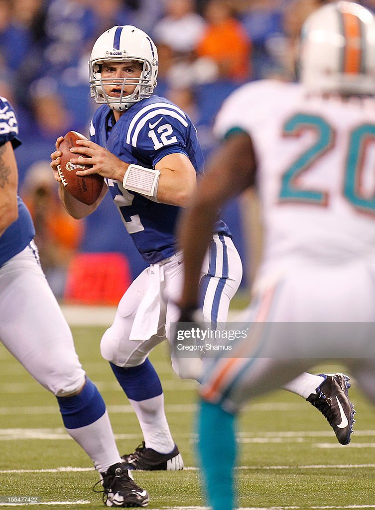 Andrew Luck #12 of the Indianapolis Colts looks for a open receiver while playing the Miami Dolphins at Lucas Oil Stadium on November 4, 2012 in Indianapolis, Indiana.