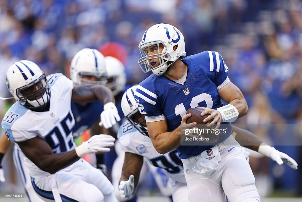 <a gi-track='captionPersonalityLinkClicked' href=/galleries/search?phrase=Andrew+Luck&family=editorial&specificpeople=6258221 ng-click='$event.stopPropagation()'>Andrew Luck</a> #12 of the Indianapolis Colts looks to throw a pass while under pressure from <a gi-track='captionPersonalityLinkClicked' href=/galleries/search?phrase=Jurrell+Casey&family=editorial&specificpeople=5551373 ng-click='$event.stopPropagation()'>Jurrell Casey</a> #99 and <a gi-track='captionPersonalityLinkClicked' href=/galleries/search?phrase=Kamerion+Wimbley&family=editorial&specificpeople=627718 ng-click='$event.stopPropagation()'>Kamerion Wimbley</a> #95 of the Tennessee Titans in the first quarter of the game at Lucas Oil Stadium on September 28, 2014 in Indianapolis, Indiana.