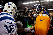 Andrew Luck of the Indianapolis Colts meets Peyton Manning of the Denver Broncos following a 2015 AFC Divisional Playoff game at Sports Authority...