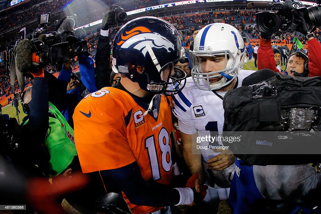 Andrew Luck #12 of the Indianapolis Colts meets Peyton Manning #18 of the Denver Broncos following a 2015 AFC Divisional Playoff game at Sports Authority Field at Mile High on January 11, 2015 in Denver, Colorado.The Colts defeated the Broncos 24-13.