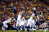 Andrew Luck of the Indianapolis Colts passes against Chandler Jones of the New England Patriots in the first half of the 2015 AFC Championship Game...