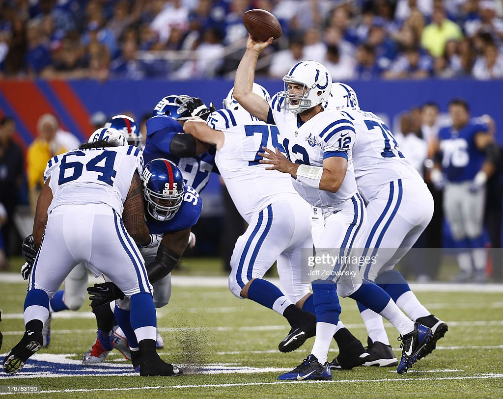 <a gi-track='captionPersonalityLinkClicked' href=/galleries/search?phrase=Andrew+Luck&family=editorial&specificpeople=6258221 ng-click='$event.stopPropagation()'>Andrew Luck</a> #12 of the Indianapolis Colts passes against the New York Giants during their preseason game at MetLife Stadium on August 18, 2013 in East Rutherford, New Jersey.