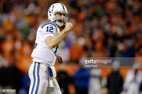Andrew Luck of the Indianapolis Colts pumps his fist to celebrate a play against the Denver Broncos during a 2015 AFC Divisional Playoff game at...