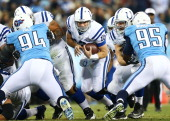 Andrew Luck of the Indianapolis Colts runs for a first down in the second quarter against the Tennessee Titans at LP Field on November 14 2013 in...