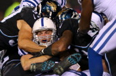 Andrew Luck of the Indianapolis Colts rushes for a touchdown during a game against the Jacksonville Jaguars at EverBank Field on November 8 2012 in...