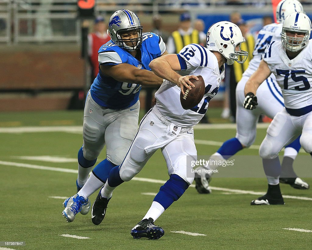 <a gi-track='captionPersonalityLinkClicked' href=/galleries/search?phrase=Andrew+Luck&family=editorial&specificpeople=6258221 ng-click='$event.stopPropagation()'>Andrew Luck</a> #12 of the Indianapolis Colts scrambles out of the reach of <a gi-track='captionPersonalityLinkClicked' href=/galleries/search?phrase=Ndamukong+Suh&family=editorial&specificpeople=5545543 ng-click='$event.stopPropagation()'>Ndamukong Suh</a> #90 of the Detroit Lions at Ford Field on December 2, 2012 in Detroit, Michigan.