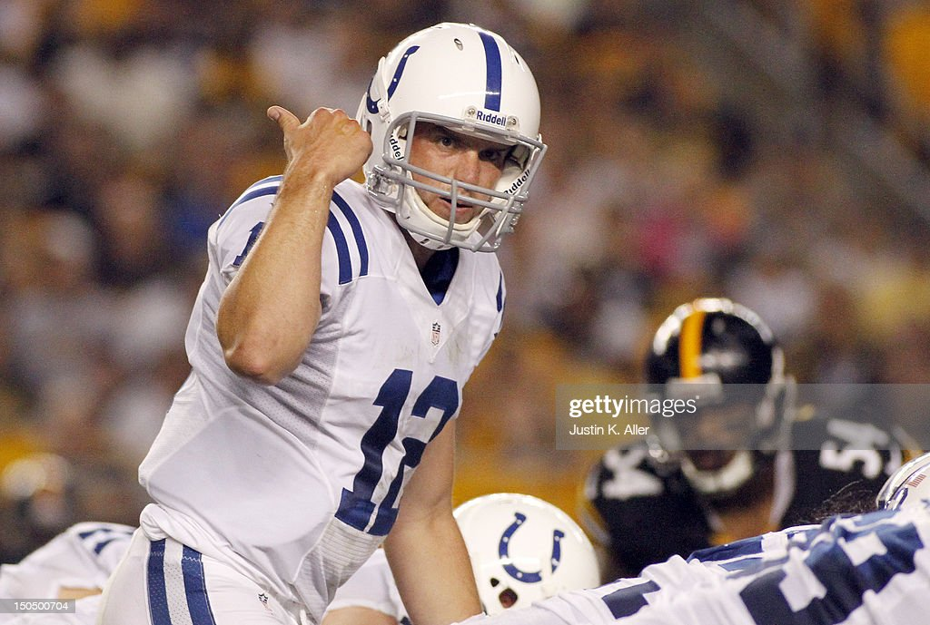 Andrew Luck #12 of the Indianapolis Colts signals to the his receiver against the Pittsburgh Steelers during the game on August 19, 2012 at Heinz Field in Pittsburgh, Pennsylvania.