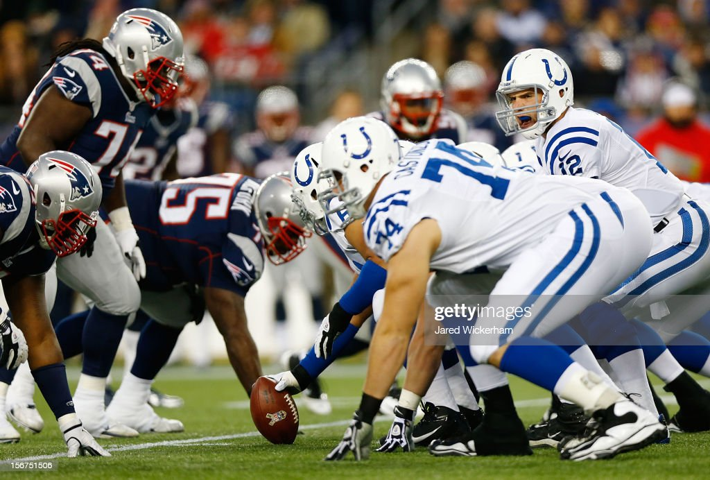 Andrew Luck #12 of the Indianapolis Colts stands behind center against the New England Patriots during the game on November 18, 2012 at Gillette Stadium in Foxboro, Massachusetts.