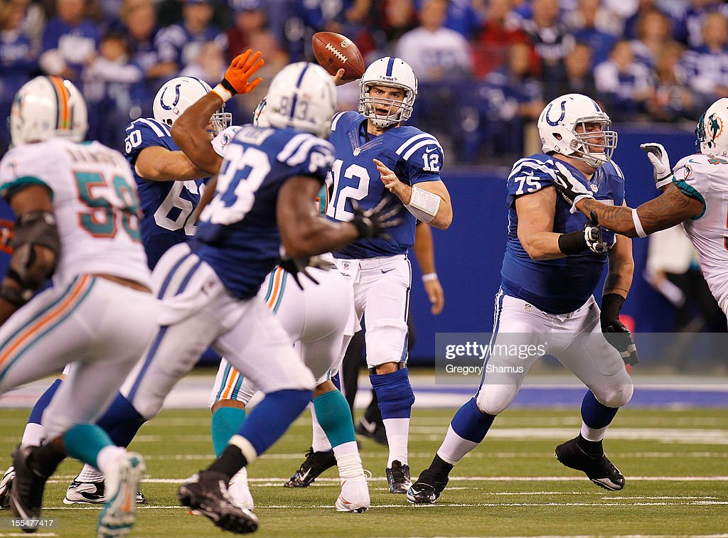 Andrew Luck #12 of the Indianapolis Colts throws a fourth quarter pass while being protected by Mike McGlynn #75 and playing the Miami Dolphins at Lucas Oil Stadium on November 4, 2012 in Indianapolis, Indiana. Indianapolis won the game 23-20.
