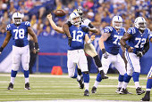 Andrew Luck of the Indianapolis Colts throws a pass as he is hit by Junior Galette of the New Orleans Saints during the exhibition game at Lucas Oil...