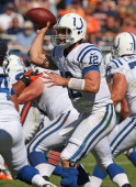 Andrew Luck of the Indianapolis Colts throws the first touchdown pass of his career against the Chicago Bears during their 2012 NFL season opener at...