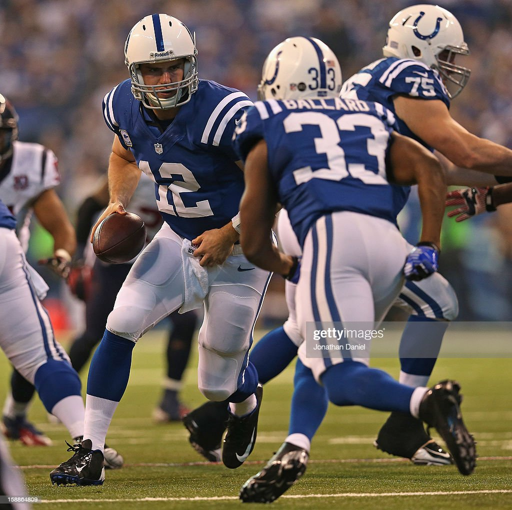 <a gi-track='captionPersonalityLinkClicked' href=/galleries/search?phrase=Andrew+Luck&family=editorial&specificpeople=6258221 ng-click='$event.stopPropagation()'>Andrew Luck</a> #12 of the Indianapolis Colts turns to hand off to <a gi-track='captionPersonalityLinkClicked' href=/galleries/search?phrase=Vick+Ballard&family=editorial&specificpeople=7265928 ng-click='$event.stopPropagation()'>Vick Ballard</a> #33 against the Houston Texans at Lucas Oil Stadium on December 30, 2012 in Indianapolis, Indiana. The Colts defeated the Texans 28-16.