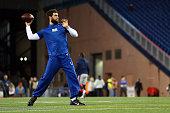 Andrew Luck of the Indianapolis Colts warms up before the 2015 AFC Championship Game against the New England Patriots at Gillette Stadium on January...
