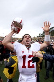 Andrew Luck of the Stanford Cardinal celebrates after beating the California Golden Bears at California Memorial Stadium on November 20 2010 in...