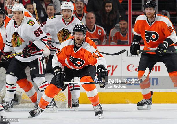 Andrew MacDonald and Jakub Voracek of the Philadelphia Flyers in action against Andrew Shaw and Marcus Kruger of the Chicago Blackhawks on March 25...
