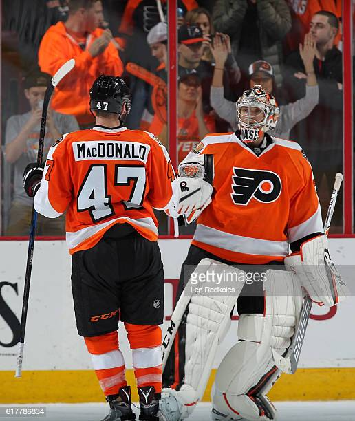 Andrew MacDonald and Steve Mason of the Philadelphia Flyers celebrate after defeating the Carolina Hurricanes 63 on October 22 2016 at the Wells...