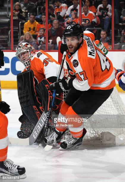 Andrew MacDonald and Steve Mason of the Philadelphia Flyers react to the play alongside the net against the New York Islanders on February 9 2017 at...