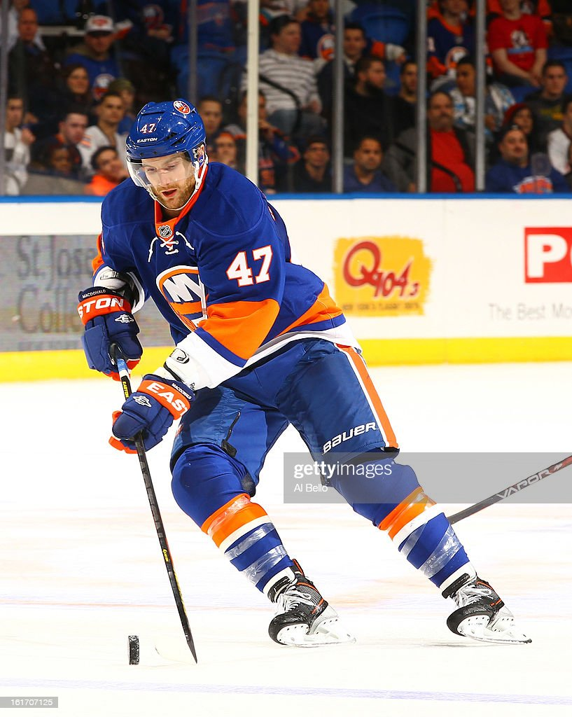 Andrew MacDonald #47 of the New York Islanders in action against the Carolina Hurricanes during their game at Nassau Veterans Memorial Coliseum on February 11, 2013 in Uniondale, New York.