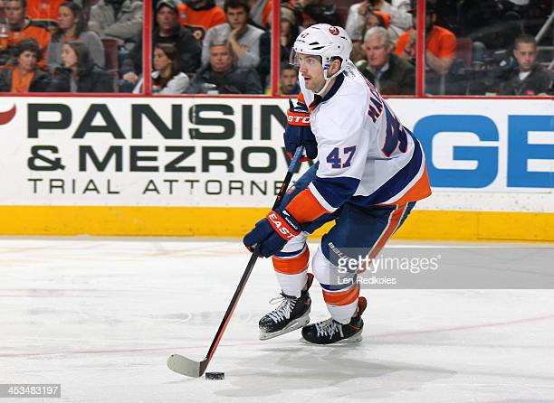 Andrew MacDonald of the New York Islanders skates the puck against the Philadelphia Flyers on November 23 2013 at the Wells Fargo Center in...