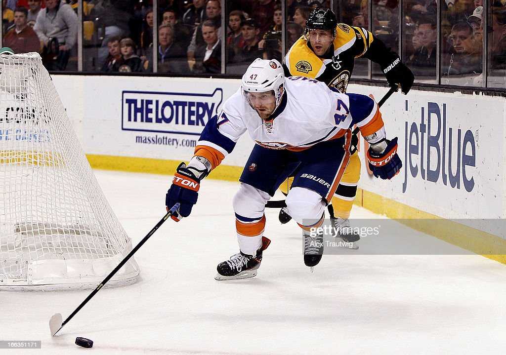 Andrew MacDonald #47 of the New York Islanders skates with the puck as <a gi-track='captionPersonalityLinkClicked' href=/galleries/search?phrase=Rich+Peverley&family=editorial&specificpeople=554442 ng-click='$event.stopPropagation()'>Rich Peverley</a> #49 of the Boston Bruins defends at the TD Garden on April 11, 2013 in Boston, Massachusetts. The Islanders defeated the Bruins 2-1.