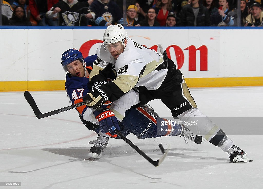 Andrew MacDonald #47 of the New York Islanders stops Pascal Dupuis #9 of the Pittsburgh Penguins from shooting at the empty net in the closing seconds of Pittsburgh's 4-3 victory at the Nassau Veterans Memorial Coliseum on March 22, 2013 in Uniondale, New York.