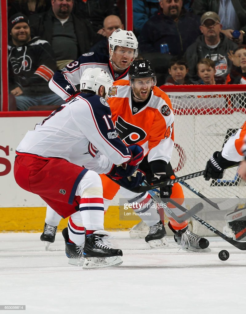 Andrew MacDonald #47 of the Philadelphia Flyers battles for the loose puck in front of the net with Scott Hartnell #43 and Brandon Dubinsky #17 of the Columbus Blue Jackets on March 13, 2017 at the Wells Fargo Center in Philadelphia, Pennsylvania. The Blue Jackets went on to defeat the Flyers 5-3.