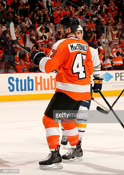 Andrew MacDonald of the Philadelphia Flyers celebrates teammate Zac Rinaldo's goal in the second period against the Buffalo Sabres at Wells Fargo...