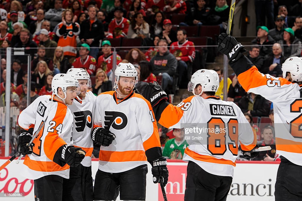 Andrew MacDonald #47 of the Philadelphia Flyers (middle) celebrates with teammates, including Matt Read #24 and Sean Couturier #14, after scoring in the first period of the NHL game against the Chicago Blackhawks at the United Center on March 16, 2016 in Chicago, Illinois.